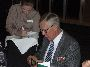 Tom Spring opening the wallet at the 3RAR Battalion Dinner
